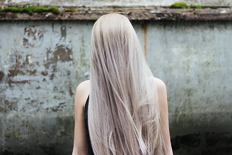 Anonymous female model with long pastel hair by Evil Pixels Photography for Stocksy United