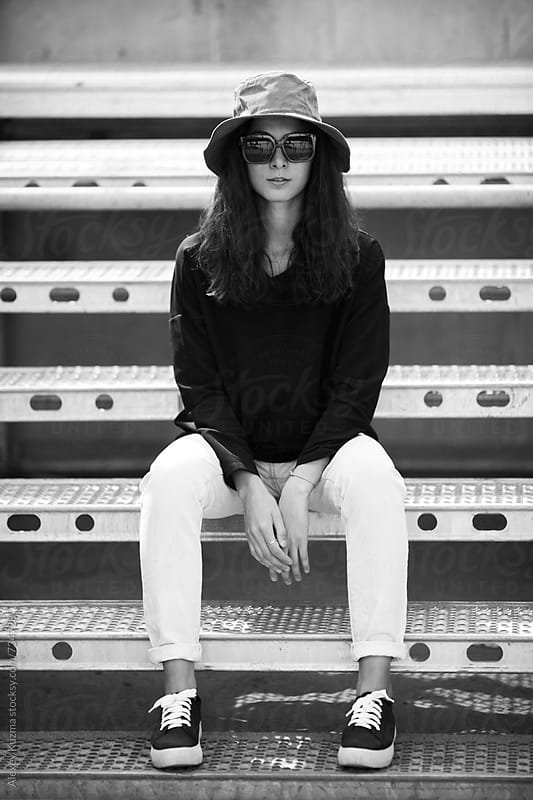 real young woman with hat and sunglasses. by Alexey Kuzma for Stocksy United