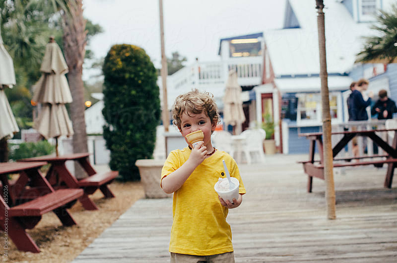 Toddler Eats Ice Cream by Ali Deck for Stocksy United