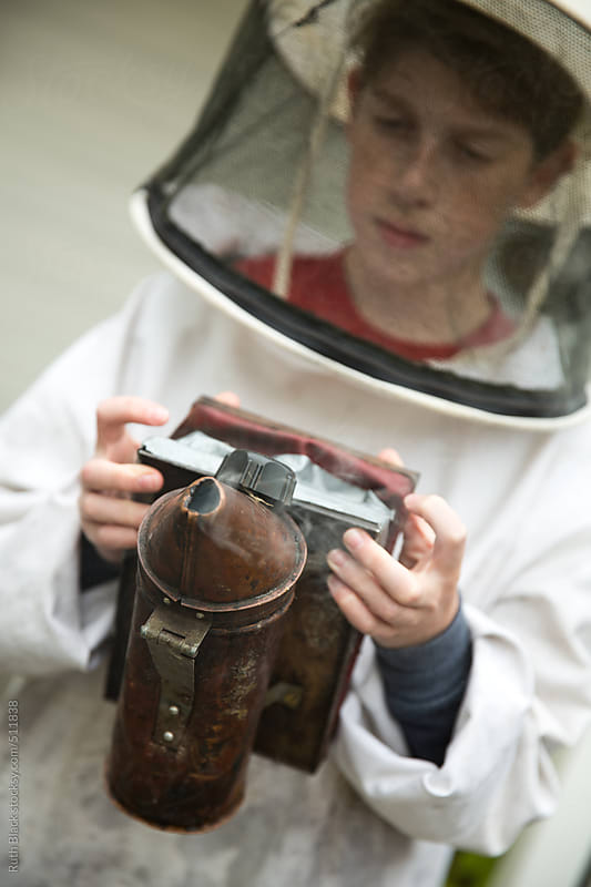 Young beekeeper by Ruth Black for Stocksy United