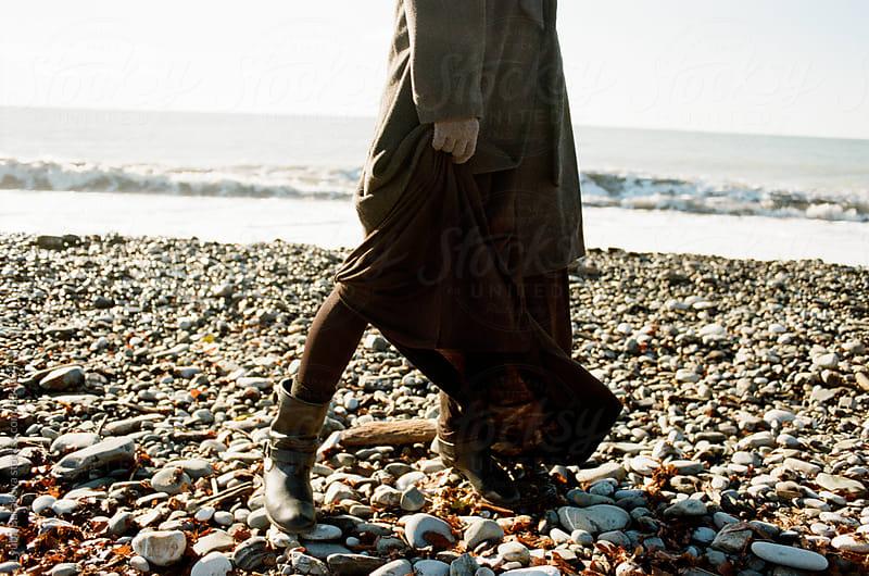 Woman standing on a seashore by Liubov Burakova for Stocksy United