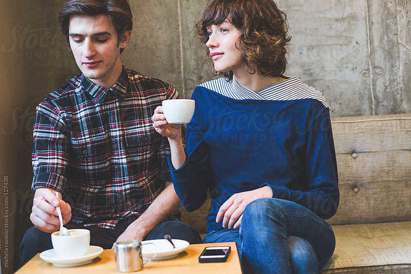 Young couple taking a coffee break by michela ravasio for Stocksy United