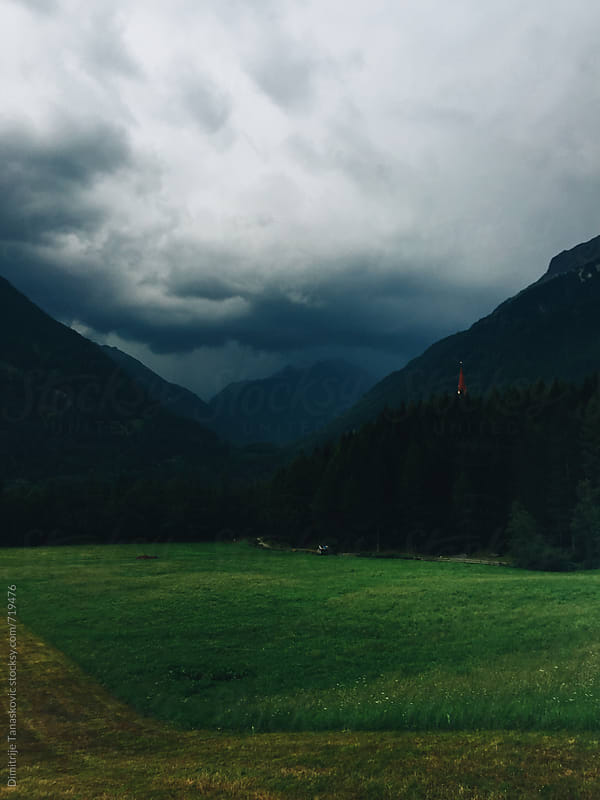 Stormy clouds in the Alps by Dimitrije Tanaskovic for Stocksy United