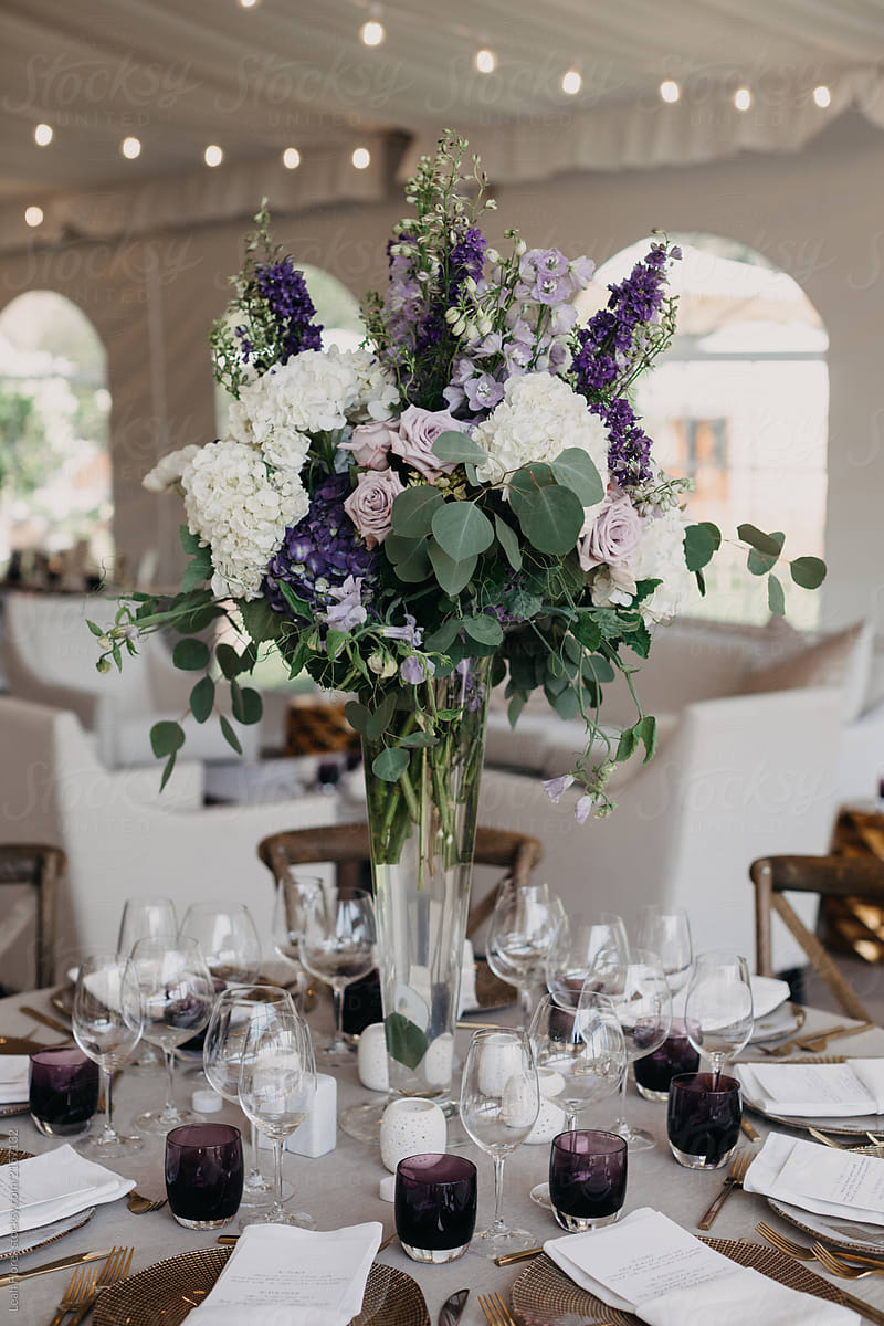 Gorgeous Purple Floral Arrangement on Table at Wedding Reception by Leah  Flores - Reception, Wedding - Stocksy United