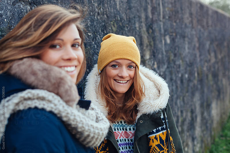 Two friends outdoors by Good Vibrations Images for Stocksy United