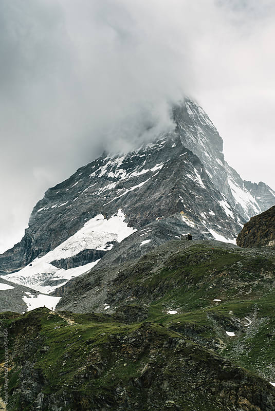Matterhorn covered in dark clouds. View from Schwarzsee, Zermatt by Peter Wey for Stocksy United