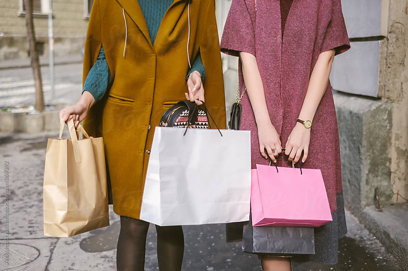 Close up of Two Women with Shopping Bags Walking Down the Street by Aleksandra Jankovic for Stocksy United