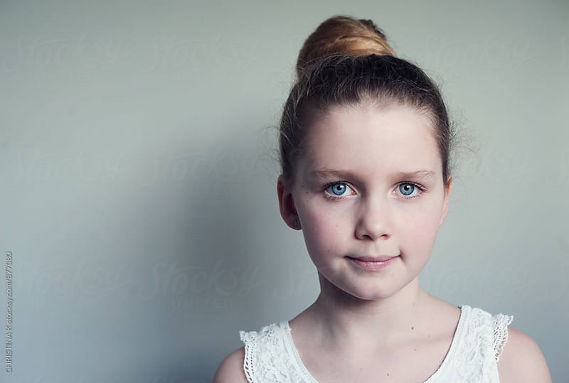 Portrait of a young girl by CHRISTINA K for Stocksy United