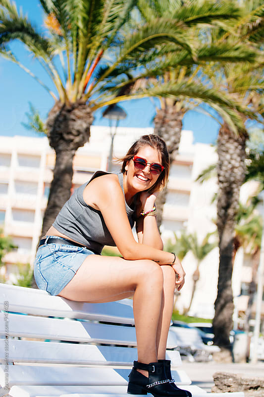 Woman smiling portrait in summer by Susana Ramírez for Stocksy United