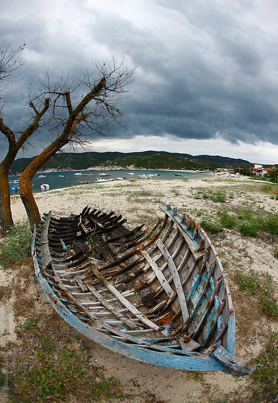 Old boat on seashore by Bratislav Nadezdic for Stocksy United