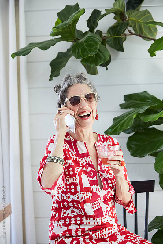Portrait of stylish senior woman on mobile phone at home by Trinette Reed for Stocksy United