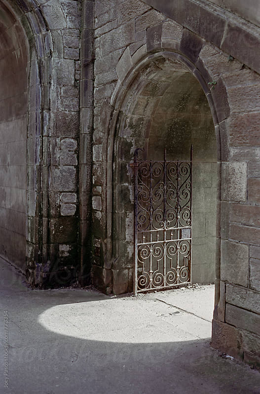 Arched stone doorway in Edinburgh by Joey Pasco for Stocksy United
