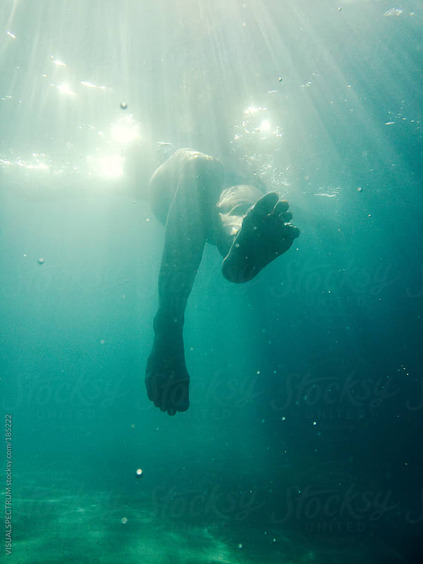 Female Legs Underwater by VISUALSPECTRUM for Stocksy United