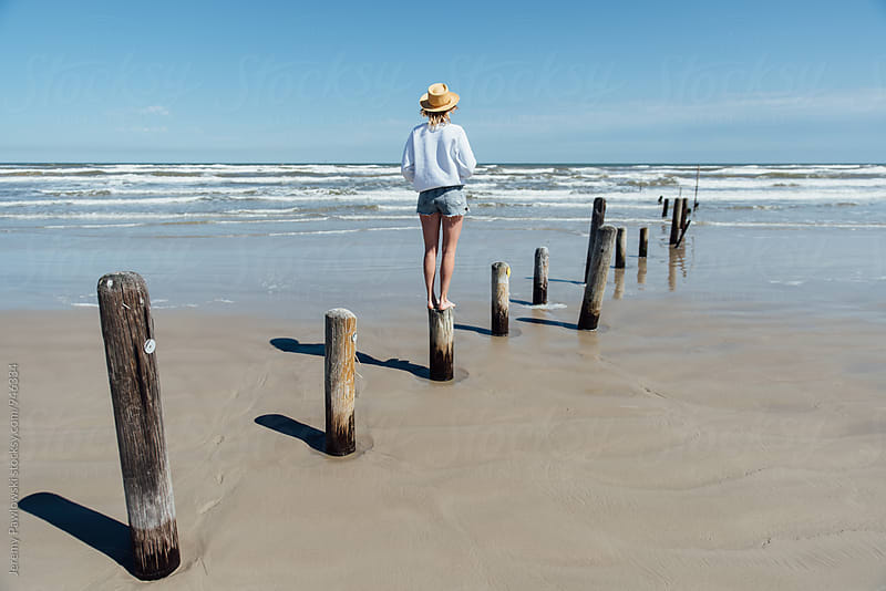 Young woman looking out at the waves of the ocean. Gulf coast. by Jeremy Pawlowski for Stocksy United