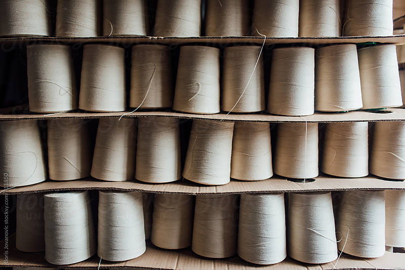 Thread rolls ready for shipping by Boris Jovanovic for Stocksy United