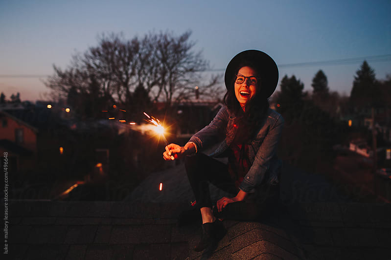 Rooftop with Sparklers by luke + mallory leasure for Stocksy United