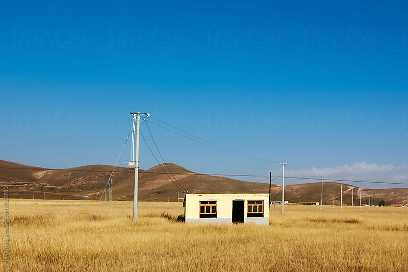 A lonely house on the prairie by zheng long for Stocksy United