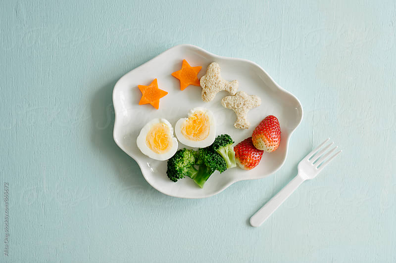 Kid's breakfast by Alita Ong for Stocksy United