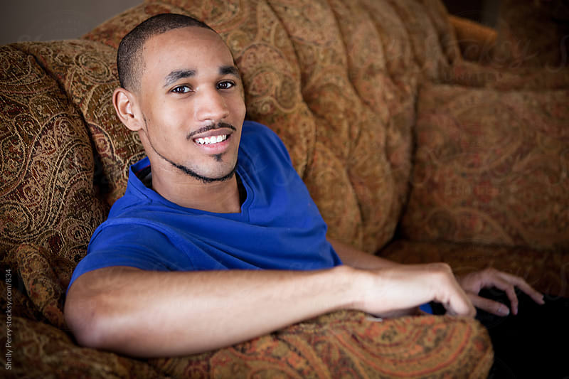 Portrait Series of a Casual Young African American Man  by Shelly Perry for Stocksy United