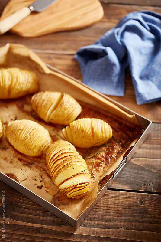 Hasselback potatoes by Martí Sans for Stocksy United