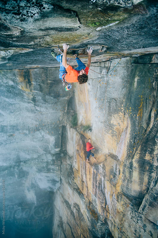 Rock Climber/Mountaineer climbing an extreme technical overhanging roof on Table Mountain by Micky Wiswedel for Stocksy United