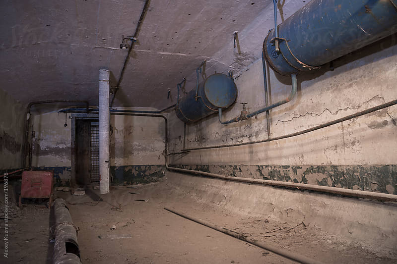 abandoned  air-raid shelter on the old factory by Alexey Kuzma for Stocksy United