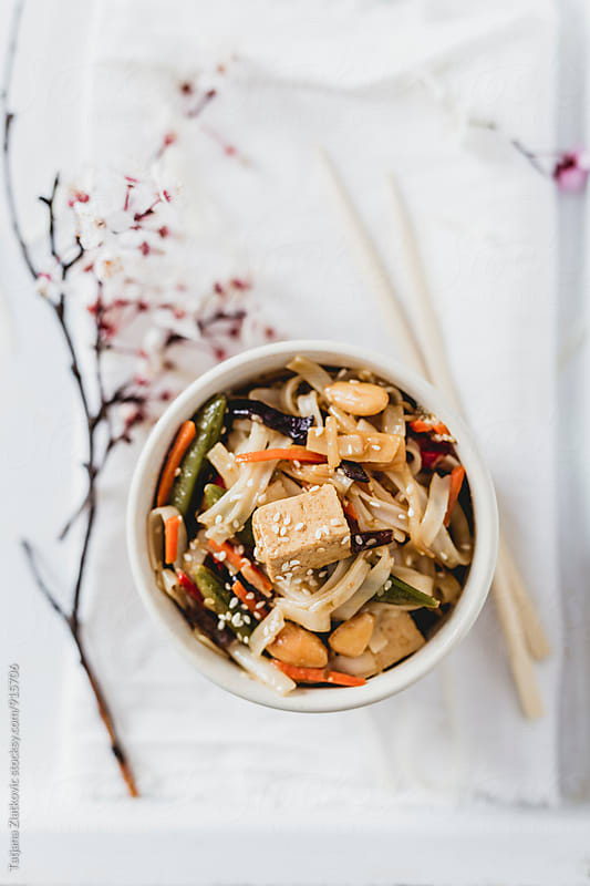 Noodles with tofu and vegetables by Tatjana Ristanic for Stocksy United
