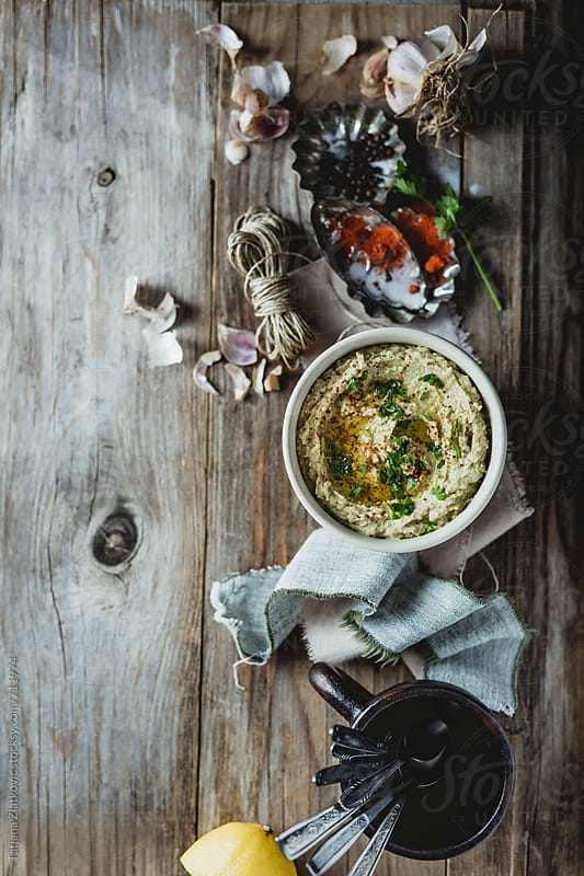 Homemade hummus with avocado by Tatjana Zlatkovic for Stocksy United
