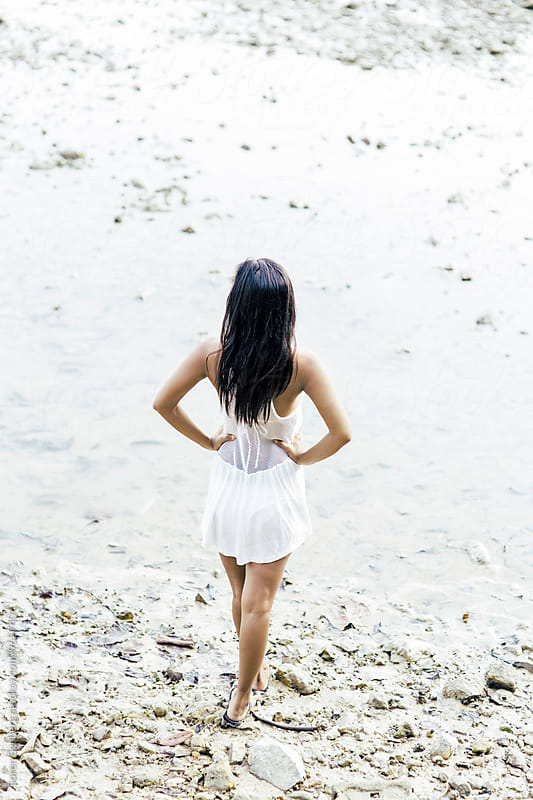 Portrait of beautiful asian woman in white dress outdoors by the sea by Soren Egeberg for Stocksy United