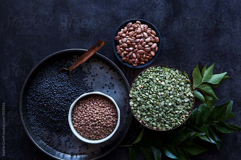 A variety of pulses and curry leaves by Nadine Greeff for Stocksy United