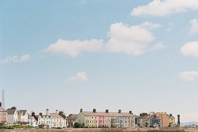 row of colourful houses in Wales by Léa Jones for Stocksy United