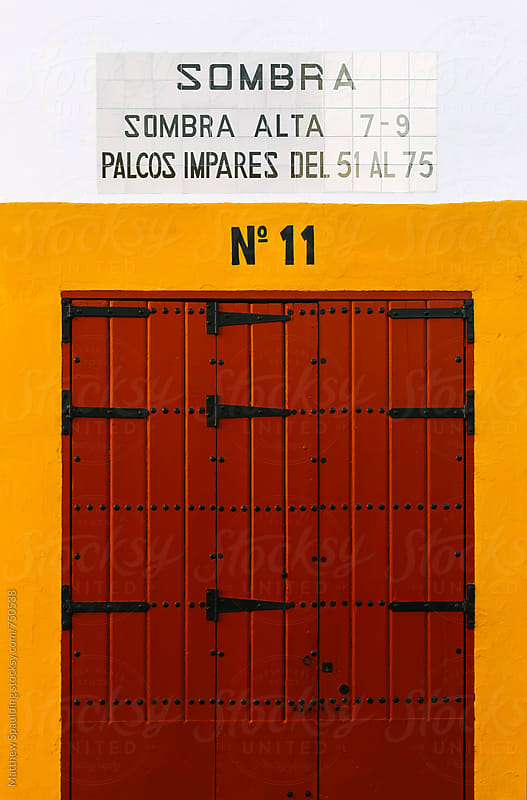 Bullfighting arena entrance door in Spain by Matthew Spaulding for Stocksy United