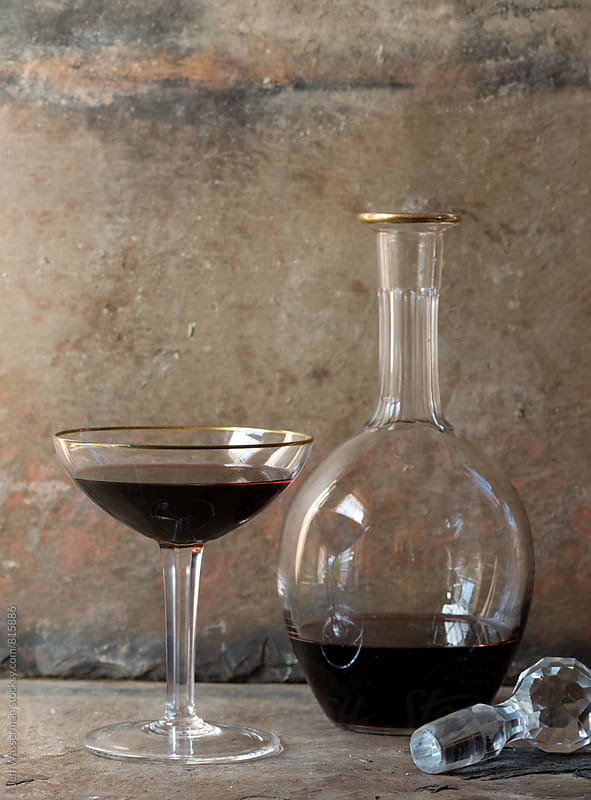 Decanter and glass of  Red Wine by Jeff Wasserman for Stocksy United