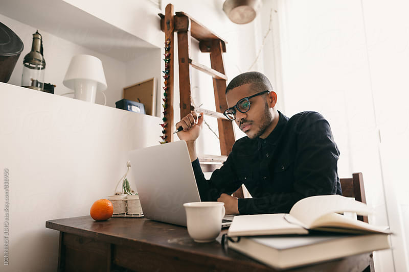Man working with laptop at home office. by BONNINSTUDIO for Stocksy United