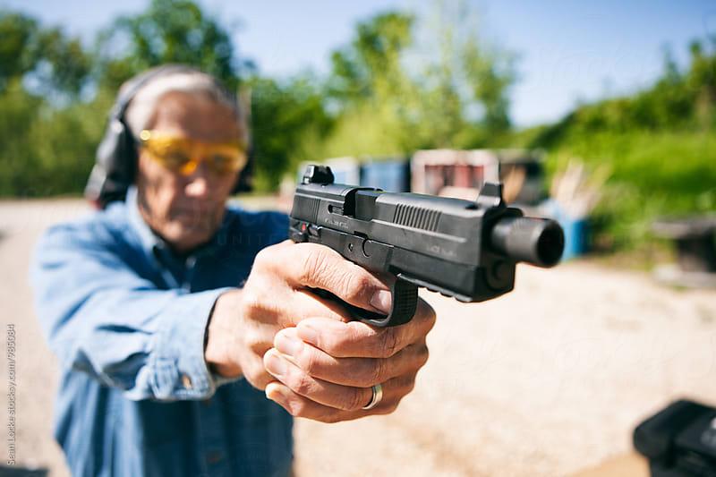 Shooting: Senior Male Aims Handgun At Target