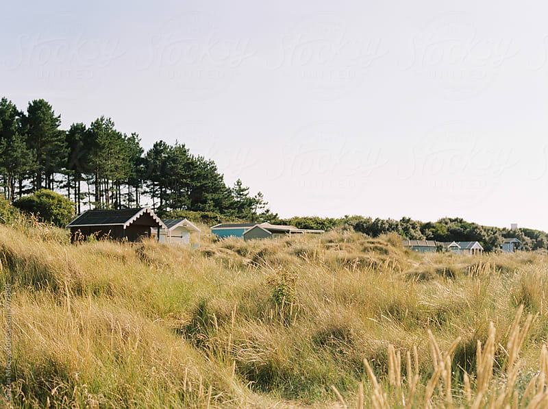Row of beach huts, Norfolk by Kirstin Mckee for Stocksy United