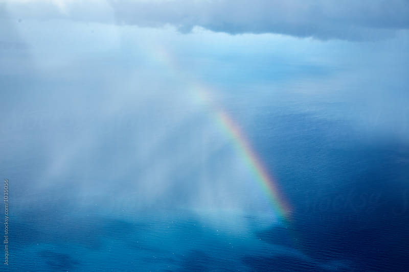 Rainbow over the Ocean from an airplane by Joaquim Bel for Stocksy United