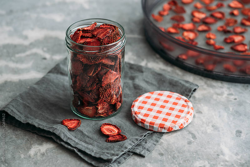 Food: Dehydrated strawberries in a jar by Ina Peters for Stocksy United