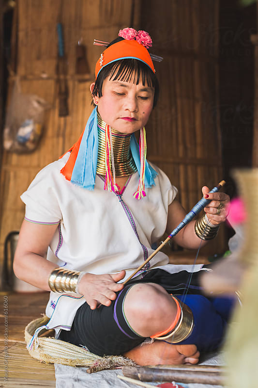 Real Lifestyle images of a Long Neck Tribal woman, Thailand. by Mauro Grigollo for Stocksy United