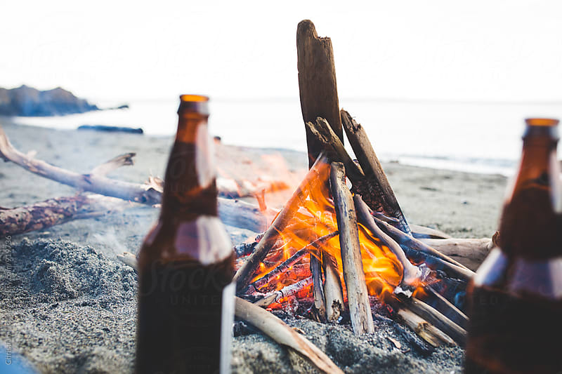Beach Fire with Beers in foreground by Christian Tisdale for Stocksy United