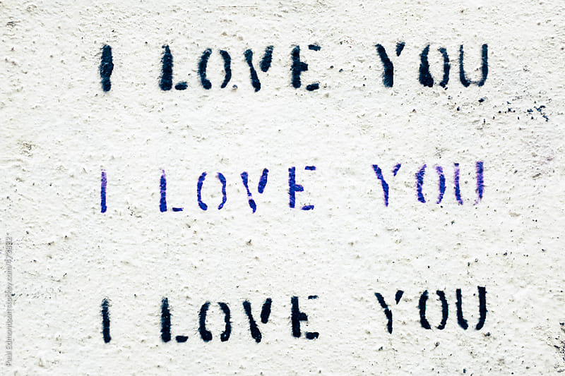 I LOVE YOU painted on exterior building wall, close up by Paul Edmondson for Stocksy United