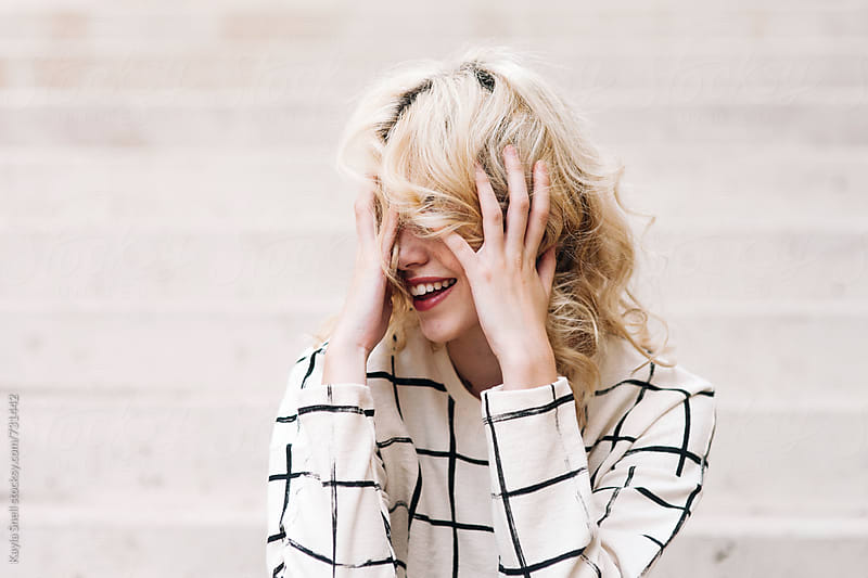 Woman laughing by Kayla Snell for Stocksy United