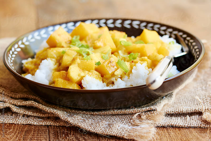 Curried Rutabaga and Apple on Rice by Harald Walker for Stocksy United