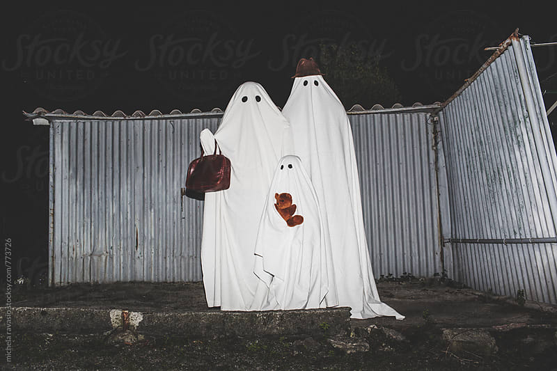 Portrait of family of ghosts outdoors by michela ravasio for Stocksy United