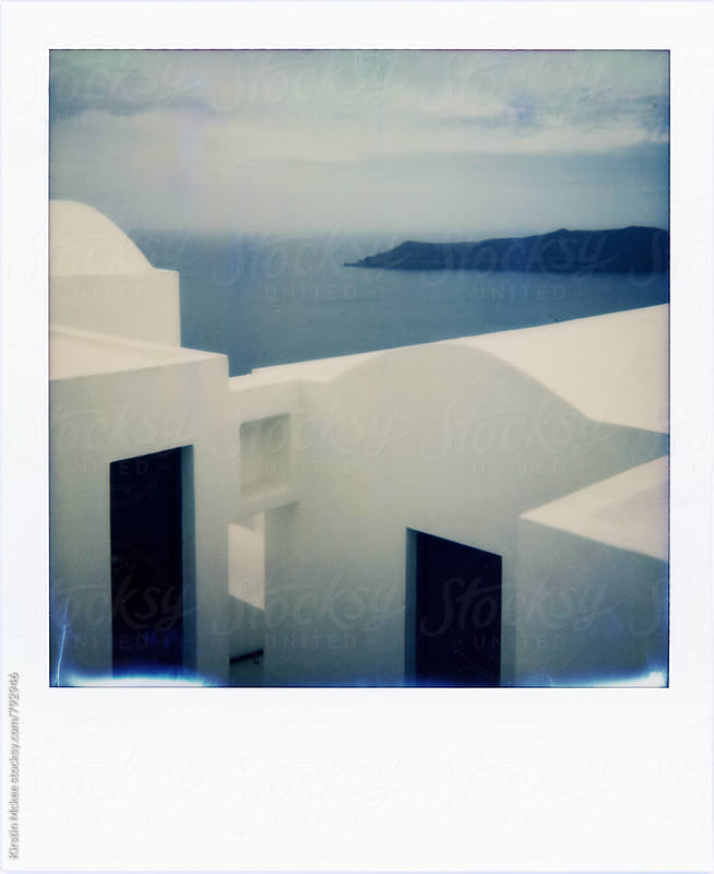 Polaroid of traditional white buildings in Santorini by Kirstin Mckee for Stocksy United