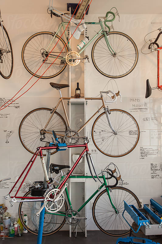 Bicycles Hung on the Wall of the Shop by Mosuno for Stocksy United