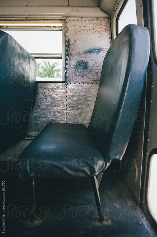 Back seat of old school bus by Stephen Morris for Stocksy United