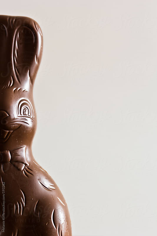 Chocolate easter bunny being destroyed by Melanie Kintz for Stocksy United