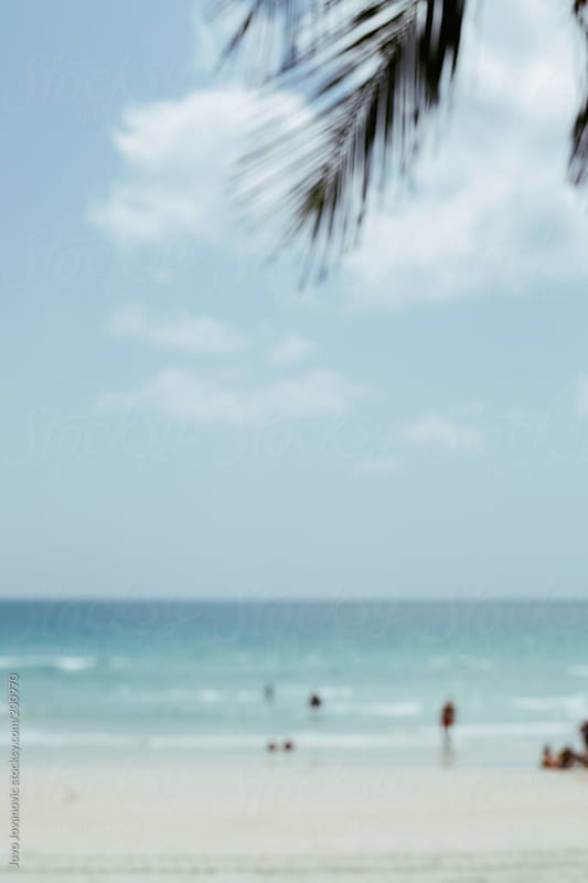 Blurry shoot of a tropical beach by Jovo Jovanovic for Stocksy United