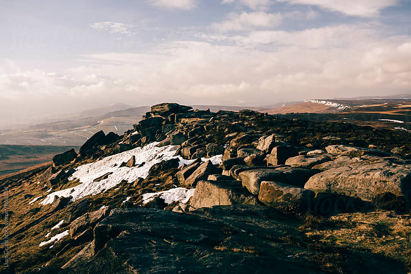 Snow on Stanage Edge at sunset. Derbyshire, UK. by Liam Grant for Stocksy United